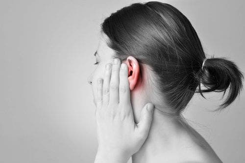 A woman with ear pain.