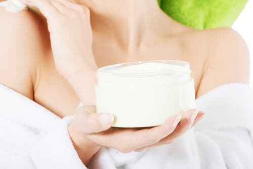 A woman holding a cream.