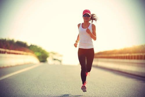Woman on the street running regular physical exercise