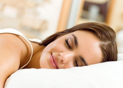 Woman sleeping and smiling.