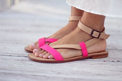 A woman wearing sandals.