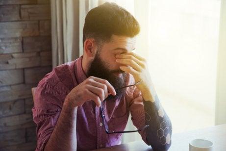 A man rubbing his eyes.