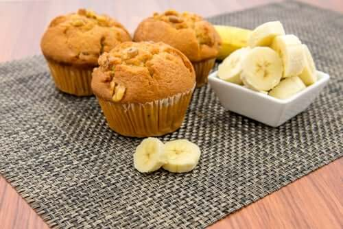 Three muffins and a cup of bananas.