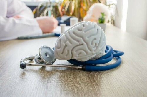 Doctor's desk with a model brain on a stethoscope.