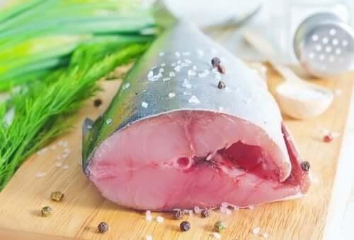 Fish on a cutting board, essential to a Mediterranean diet.