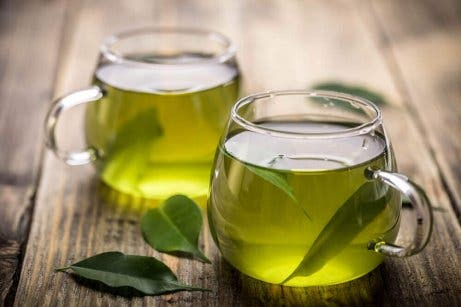 Cups of green tea, a supplement for treating obesity.