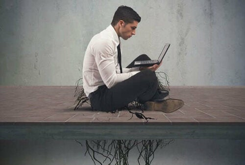 Man on laptop with roots keeping him on the ground, porn addiction.
