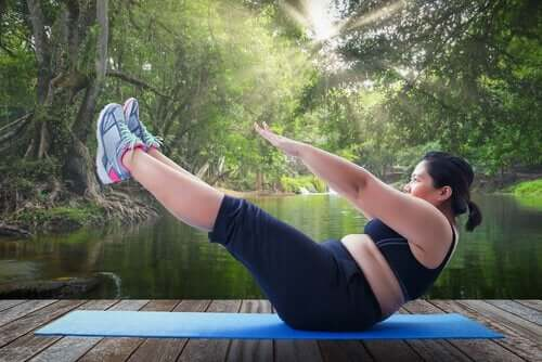 An overweight woman exercising.