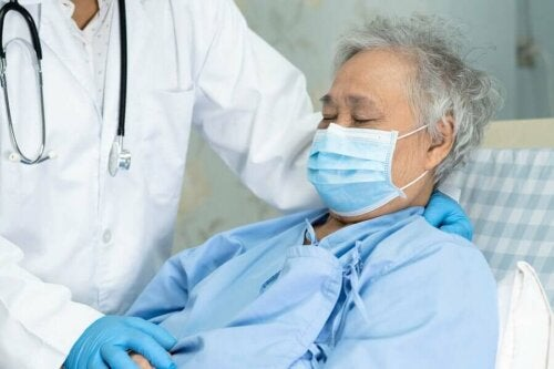 A patient and doctor wearing protective equipment.