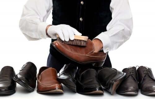 A man shining shoes.