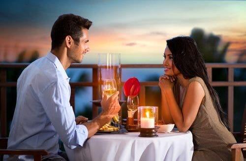 A couple enjoying a romantic dinner.