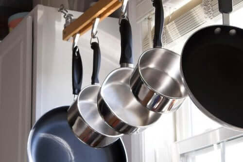 A set of stainless steel pots.