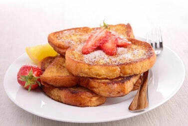 Vegan french toast with strawberries on top.