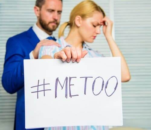 A woman holding a #MeToo poster.