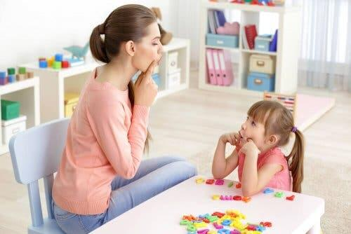 Mom teaching daughter to be bilingual.