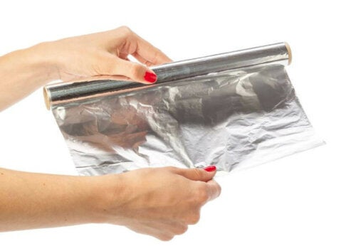 A person getting some aluminum foil.