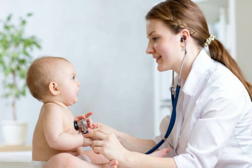 Pediatrician checking baby's heart with stethoscope.