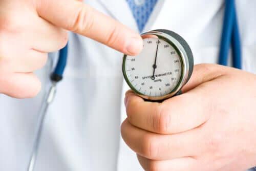 A doctor measuring blood pressure.