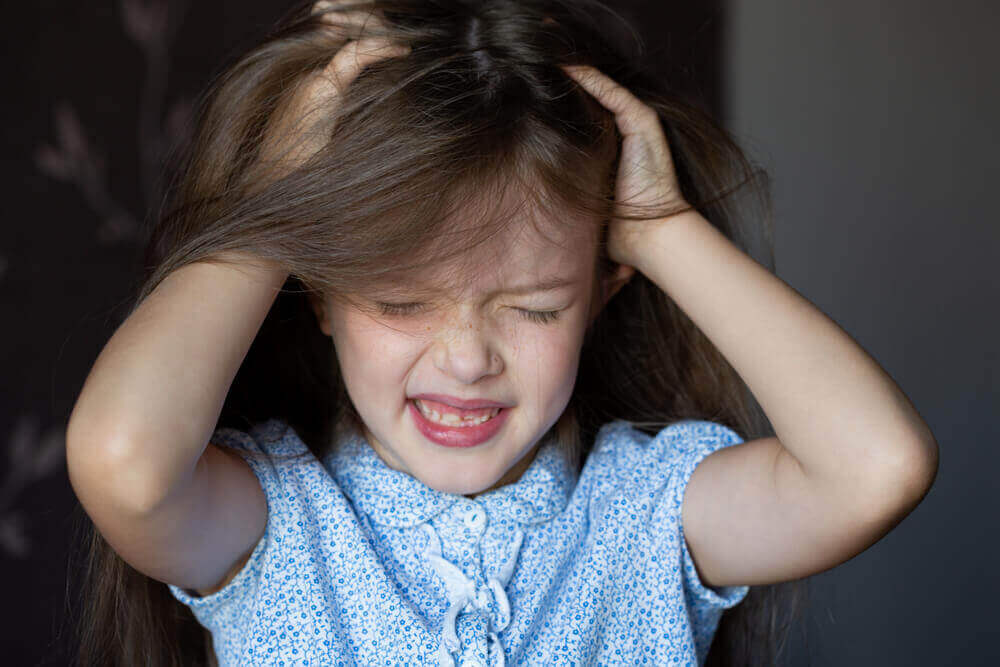 A child pulling her hair out.