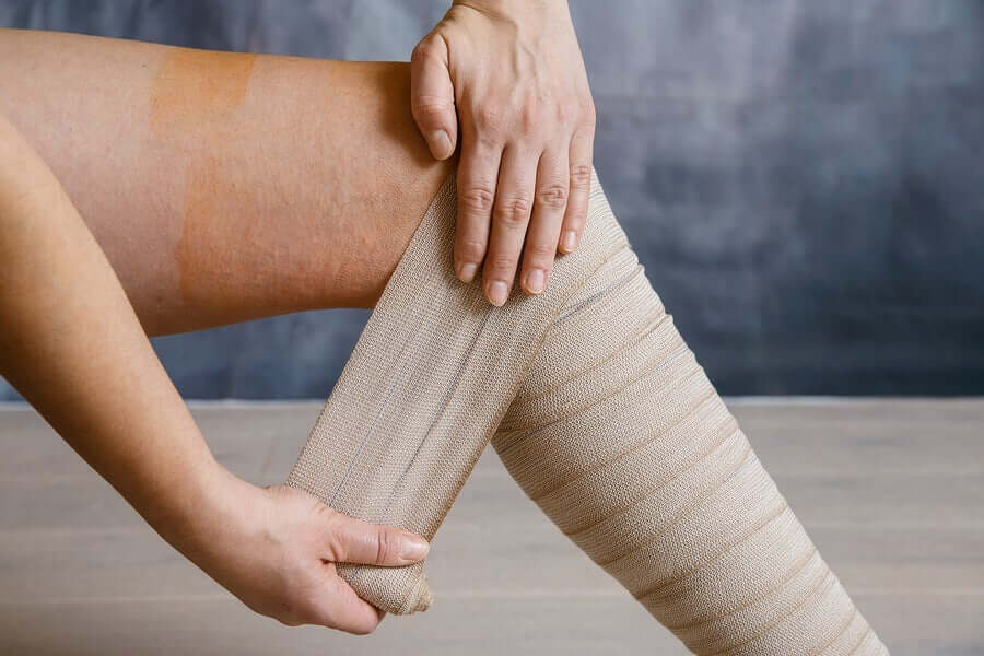 A person putting on compression bandages due to heavy legs.