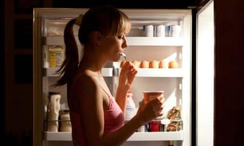 Woman eating at night.