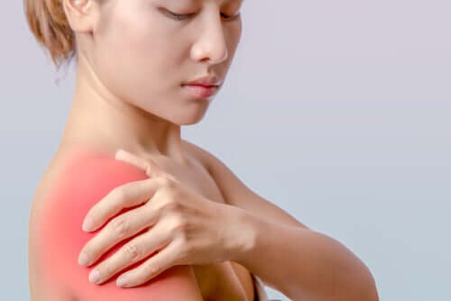 A woman with a sore shoulder.