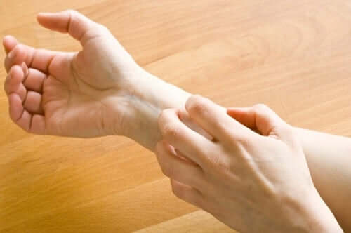 A person scratching their wrist.