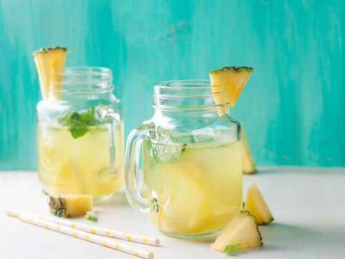 A couple glasses of pineapple drink.