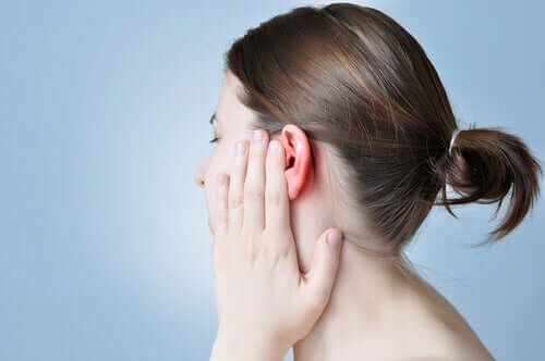 A person with ear pain.