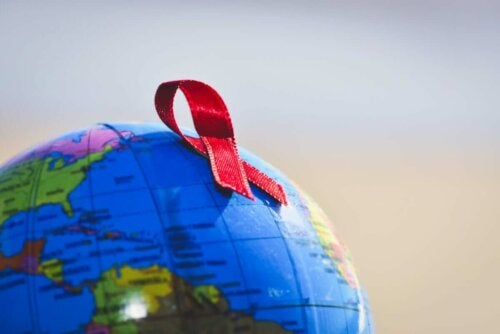 A red ribbon on a globe.