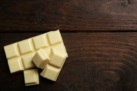 A white chocolate bar on the table.