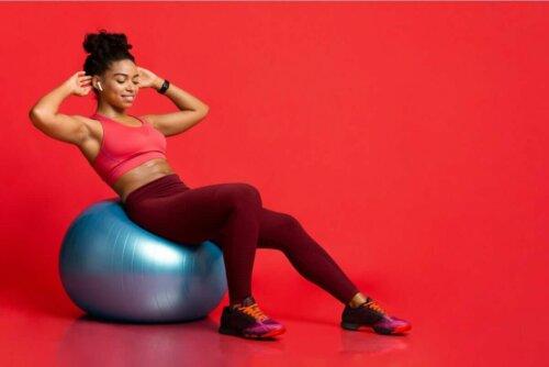A woman exercising on a yoga ball.