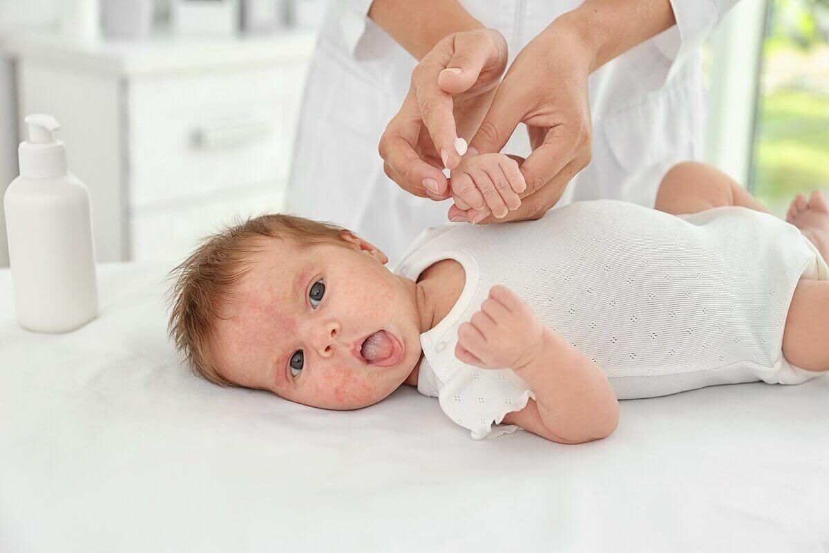 A baby on a mat.