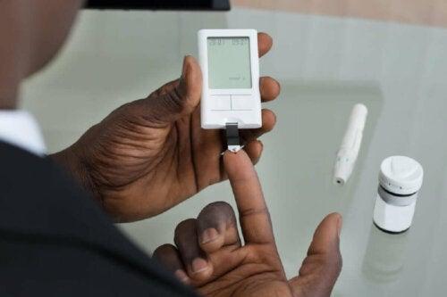 A diabetic patient measuring his blood sugar level.