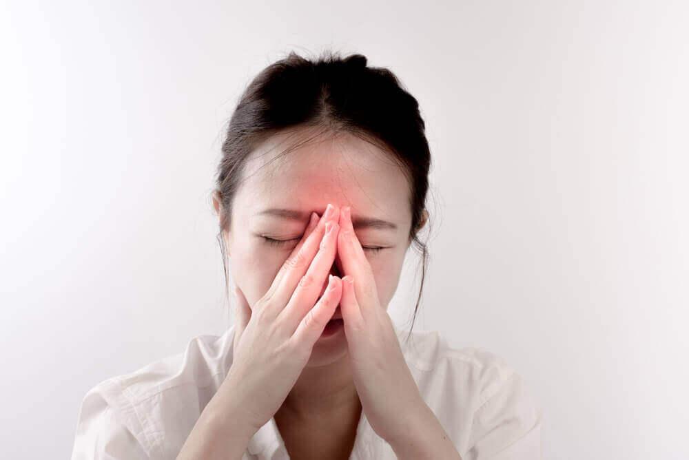 A woman experiencing a headache.