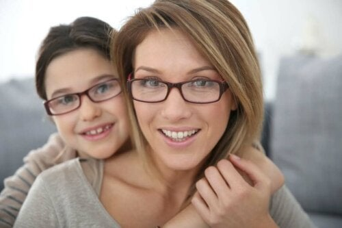 A mother and daughter wearing glasses.