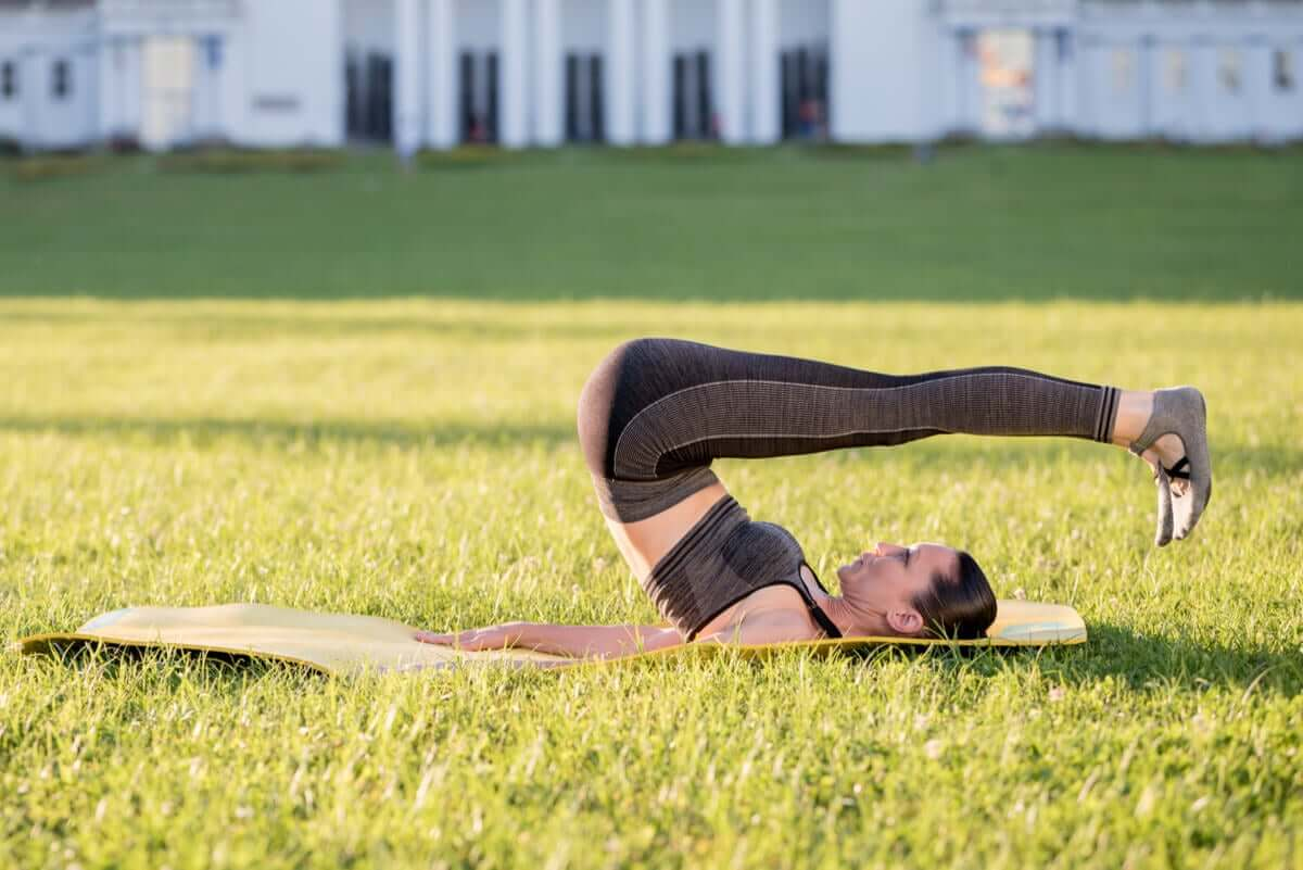 The rolling back Pilates exercise.