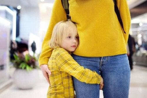 A child hugging her mom.
