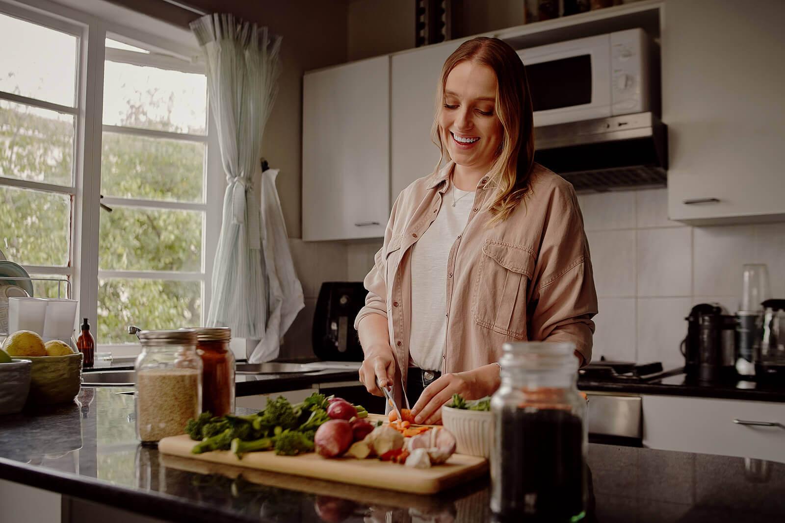 A woman preparing dinner.