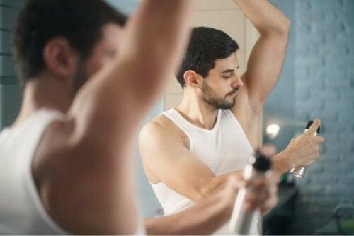 A man applying deodorant.