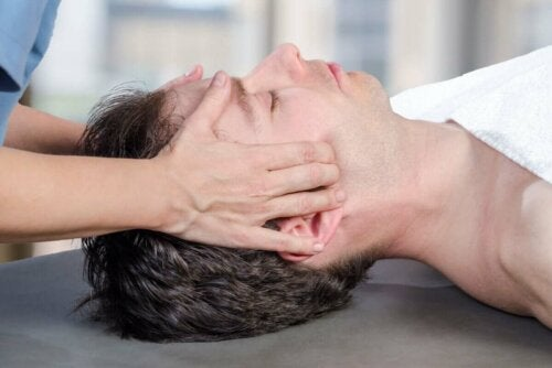 A person getting a jaw massage.