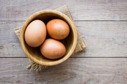 Three eggs in a bowl.