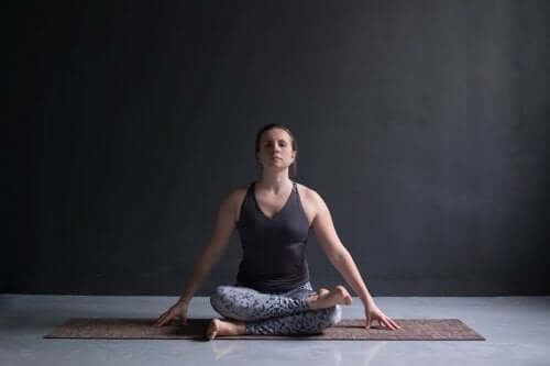 Woman doing yoga to achieve better rest