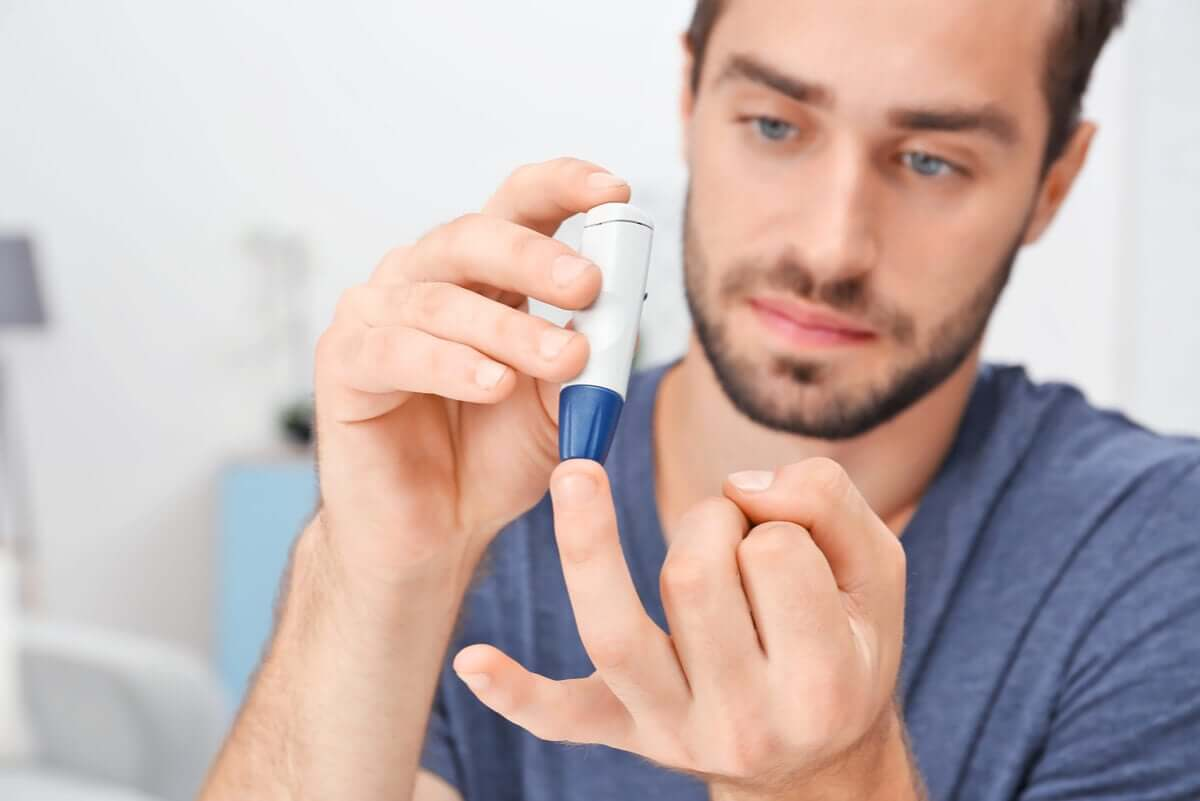 A man with diabetes measures his glucose.