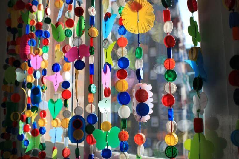 A curtain made from bottle tops.