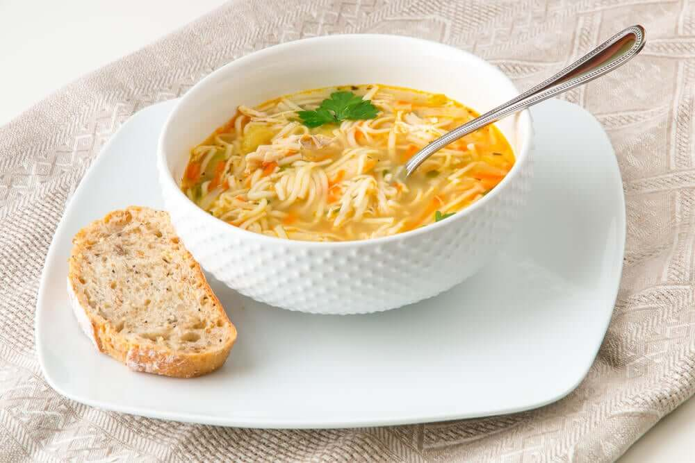 A bowl of chicken noodle soup.
