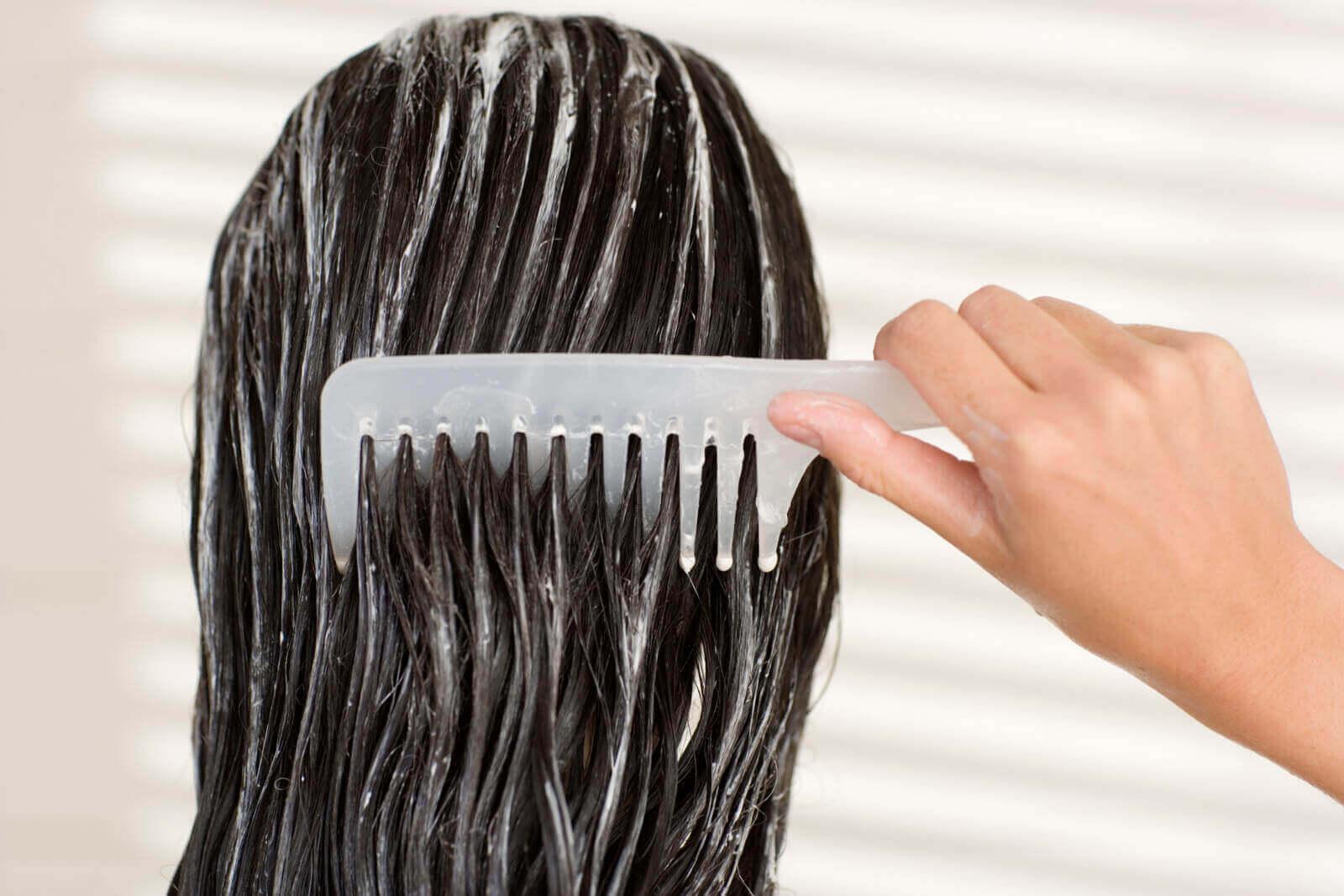 Combing hair.