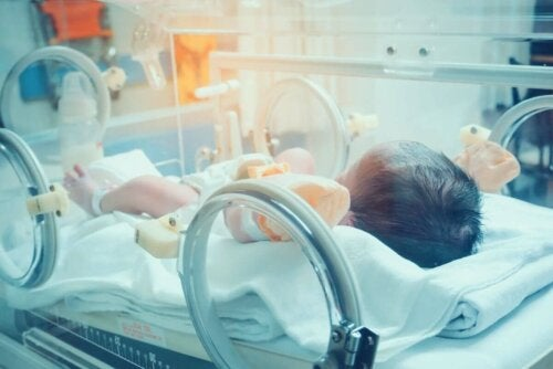 A premature baby in an incubator.