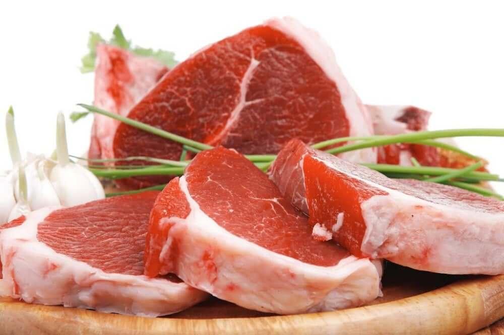 Raw steaks on a cutting board.