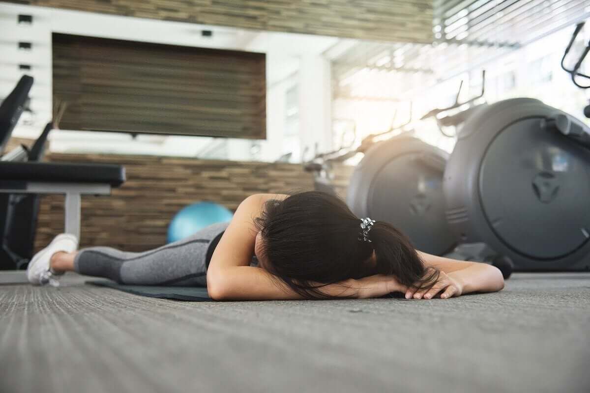 An unconscious person in a gym.
